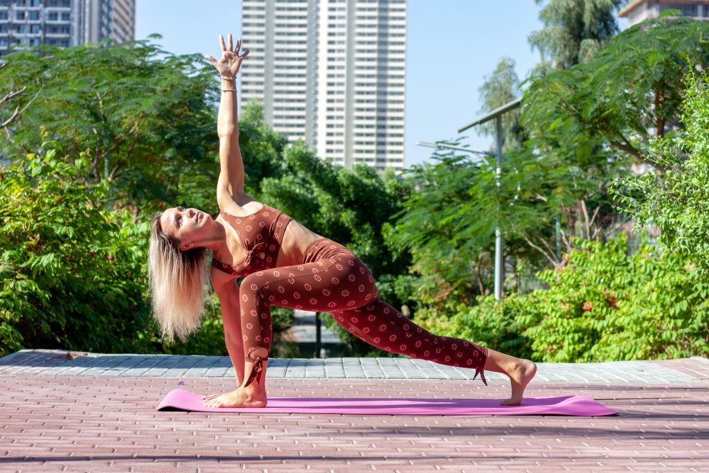 Triangle yoga posture in the park
