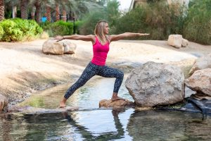 Warrior yoga posture in the park