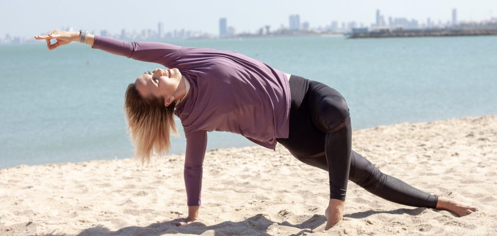 Beautiful yoga posture on the beach in Kuwait